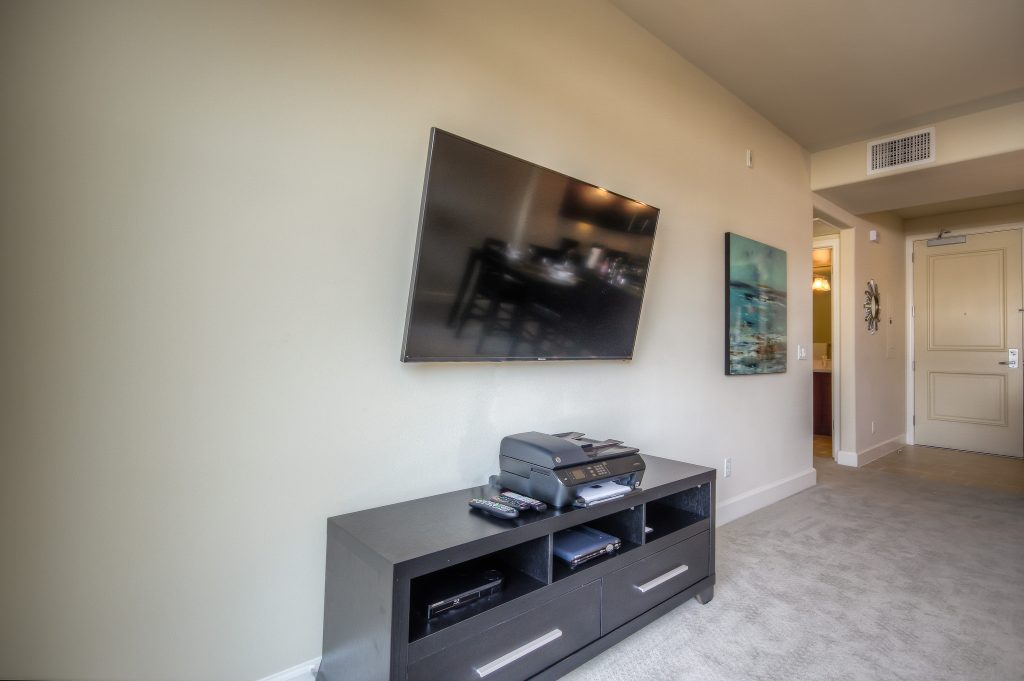 Spacious living room with television at Bedford Corporate Housing's property in Glendale Americana. For the best furnished rentals in Los Angeles, contact Bedford.
