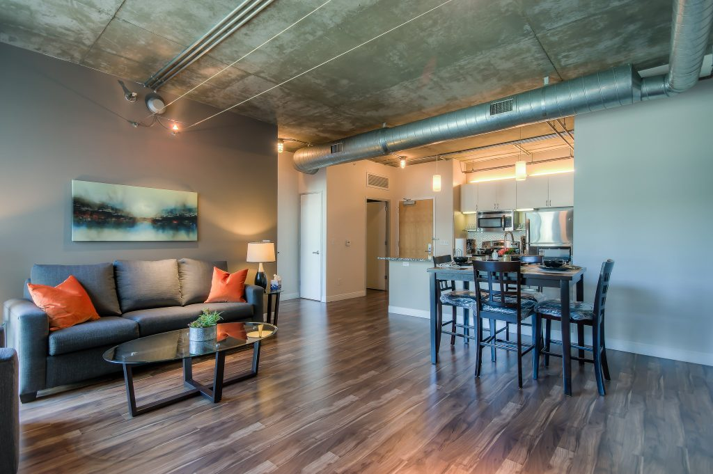 Modern furnished living rooms in every unit at Bedford Corporate Housing's property in Downtown LA near LA Live. For the best corporate housing in Los Angeles, contact Bedford.