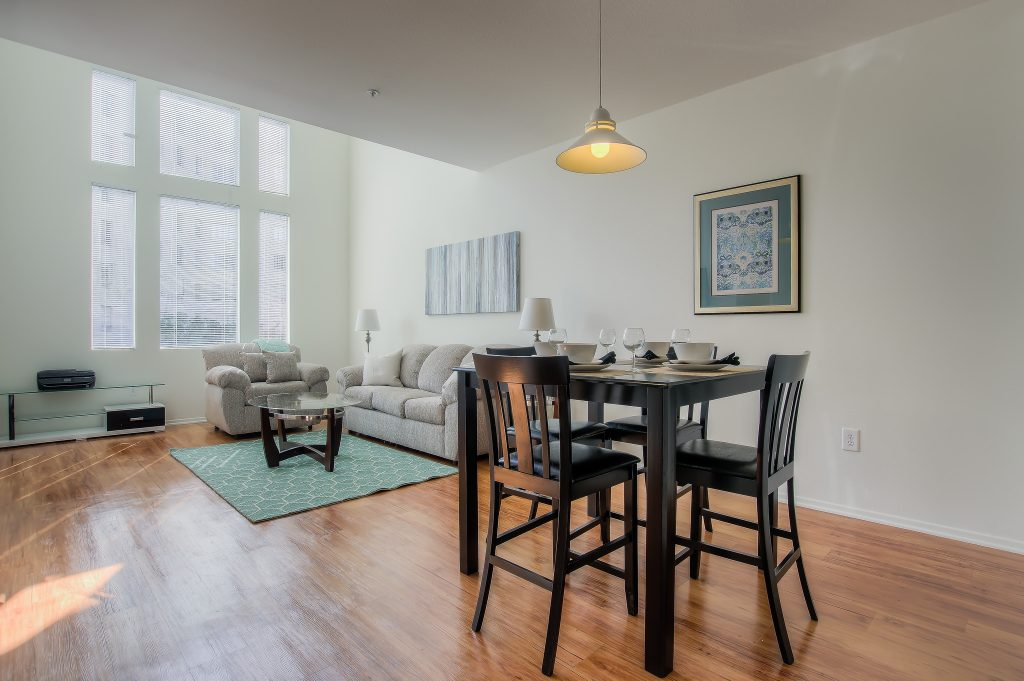 Furnished living rooms with high-def televisions at Bedford Corporate Housing's property in Hollywood near The Grove East/West. For the best corporate apartments in Los Angeles, contact Bedford.