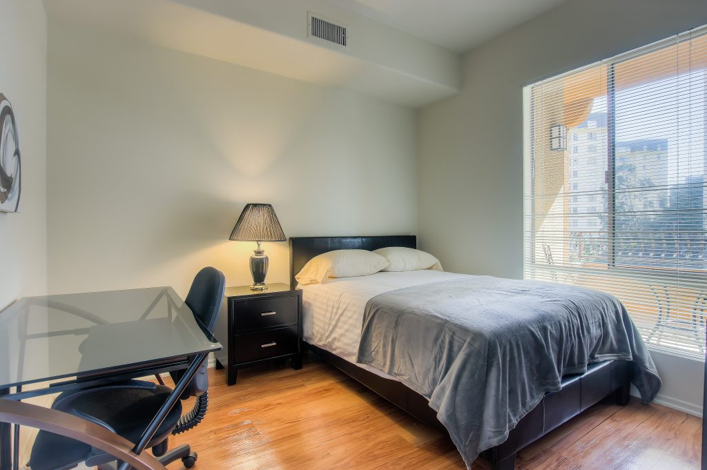 Beautiful spacious bedroom at Bedford Corporate Housing's property in Hollywood near The Grove East/West. For the best short term apartments in Los Angeles, contact Bedford.