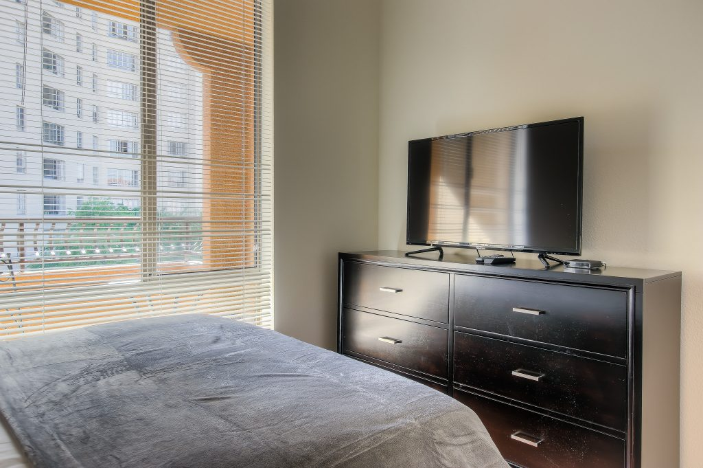 Spacious bedroom with television included with every unit at Bedford Corporate Housing's property in Hollywood near The Grove East/West. For the best short term rental in Los Angeles, contact Bedford.