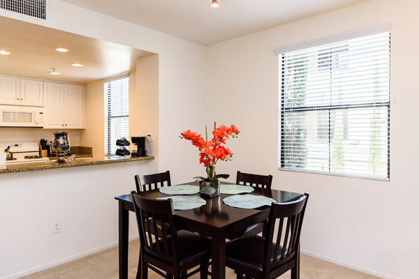 Furnished dining rooms in every unit at Bedford Corporate Housing's property at Irvine Village. For the best Short Term Apartments in Los Angeles, contact Bedford.