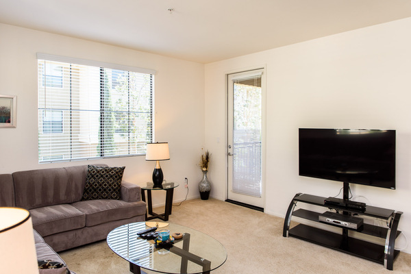 Furnished living rooms in every unit at Bedford Corporate Housing's property at Irvine Village. For the best Furnished Rentals in Los Angeles, contact Bedford.