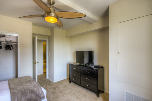 Bedrooms with high-def televisions at Bedford Corporate Housing's property in Hollywood near The Grove Towers. For the best furnished apartments in Los Angeles, contact Bedford.